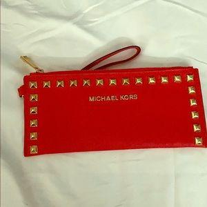 Authentic Michael Kors wristlet.